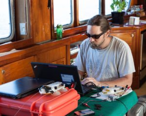 Ari at work programing a DTAG. NOAA research permit #14122 copyright 2013 Gina Ruttle/Whalegeek